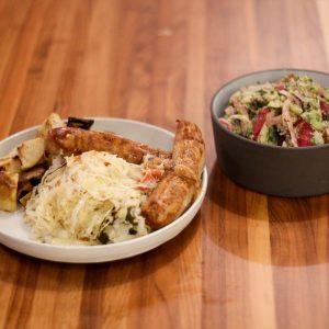 Choucroute garnie: beer-braised bratwurst, German potato salad, roasted root veggies, braised cabbage with sauerkraut, and roasted apple mustard.
