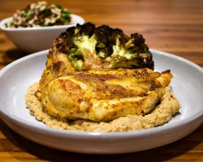 Harissa Roasted Chicken Breast, Cauliflower With Za'atar + Golden Raisins, Wild Rice + Fresh Herbs, And Eggplant Babaganoush