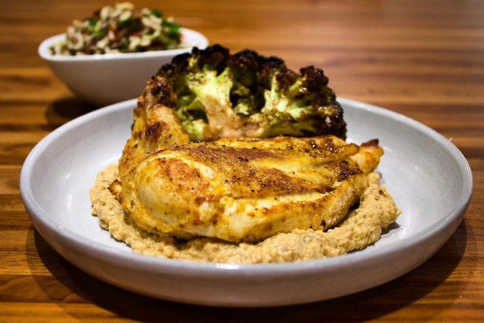 harissa roasted chicken breast, cauliflower with za'atar + golden raisins, wild rice + fresh herbs, and eggplant babaganoush