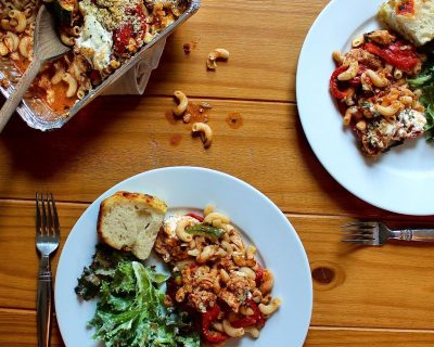 Tuscan Roasted Chicken, Blistered Peppers, Summer Squash + Noodles, Baked In A Sweet Tomato Sugo With Whipped Ricotta, Mozzarella + Parmesan Breadcrumbs. Housemade Focaccia With Blistered Cherry Tomatoes + Basil. Mixed Green Salad With Creamy Caesar Dressing.